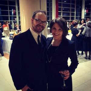 Carly with husband, Ryan, dressed to the nines at a theatre gala.